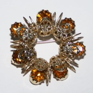 Gold and yellow topaz vintage brooch